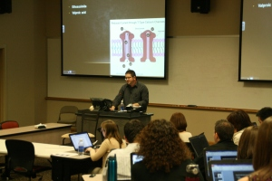 P4 Student Brian Holmes lecturing on anti-seizure medications to P2 pharmacology students.