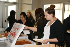 "UCSOP students line up for the pizza portion of the ""Pizza and Policy"" discussion"