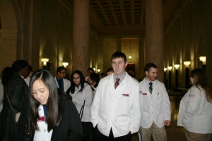 UC student pharmacists gather in the WV Capitol Rotunda to prepare for the activities of the day.