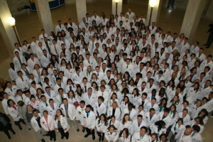 Student pharmacists from UC, WVU, and MU pose in the Rotunda.