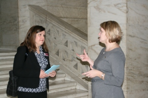 Dr. Kristy Lucas, UC faculty member, talks with Dr. Krista Capehart, WVU faculty member.