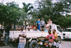 UCSOP Students Ride in the Back of a Truck from Airport to Haitian Town