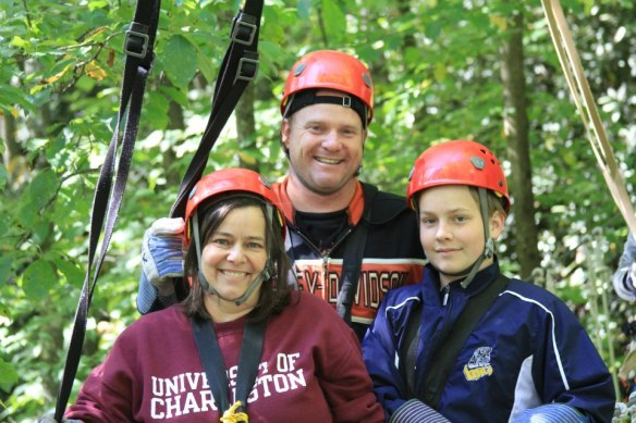 Staff member Erika Riggs and her family are preparing to go zip-lining.
