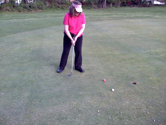3rd Floor Administrative Assistant Marea Dodd learning to golf.