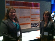 P4s Brandi Sugonis and Jennifer Leslie presenting a poster on Cancer Prevention.