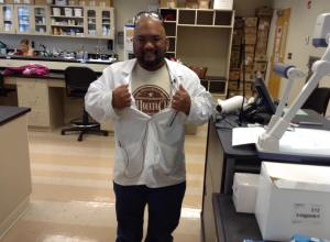Advisor Ron Ramirez proudly wears his letters in his lab at UCSOP.
