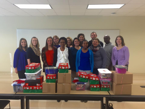 On the right, Dr. Leah Hall along with CPFI Members and the 24 boxes we were able to pack for needy children.