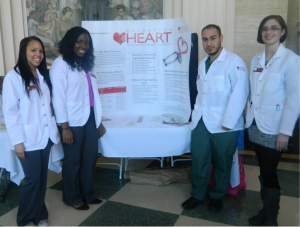 P3s LaTasha Marshall and Beverly Okoroji, P2 Rafi Saadallah, and P4 Melanie Richmond present a poster for APhA's Operation Heart.