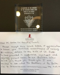 Plaque and thank-you note from St. Jude's Children Research Hospital thanking Phi Delta Chi for their support.